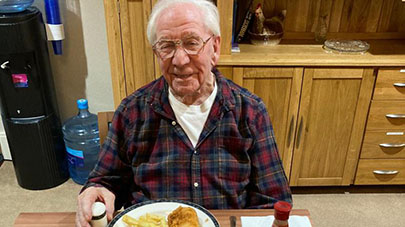 Resident enjoying fish and chips