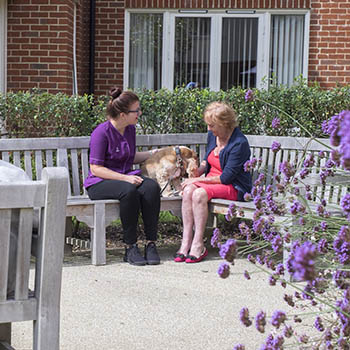 People sat in a care home garden