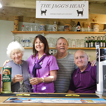 Manager Mary Hardy, residents Sylvia Rogers and Roger Nelson in Birkenhead Court's pub with Caretaker Paul Todd