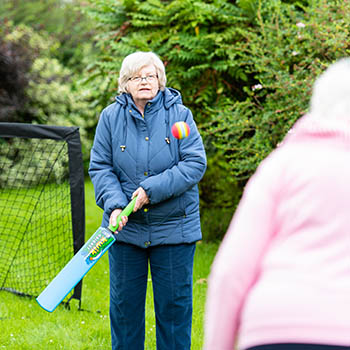 Residents playing cricket