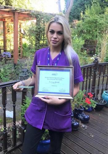 Kareiss Goodall receiving award