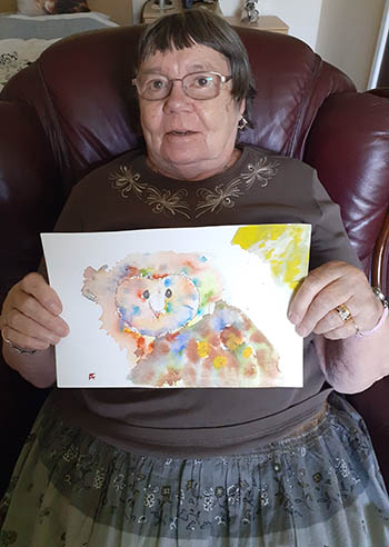 Resident with her artwork