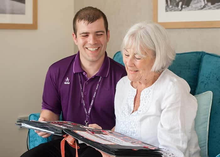 Male carer with resident