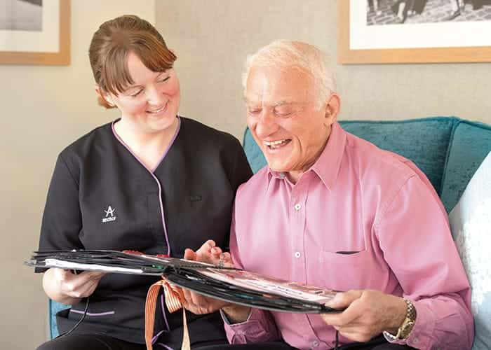 A resident and a staff member talking