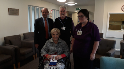 Malthouse Court residents and staff at a retirement housing scheme welcome a representative of the queen