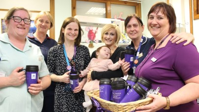 Orchard Gardens care home donate thermos mugs to help new mums in hospital