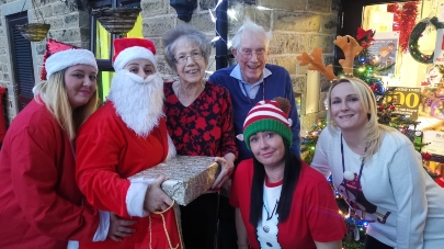Father Christmas and his elves switch on lights at Tolson Grange care home