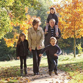Grandparents and grandchildren walking in the park