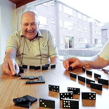 Gentleman playing dominoes