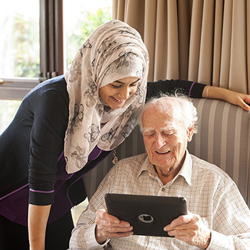 A carer and resident uisng an iPad