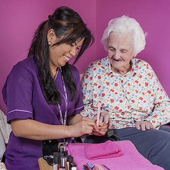 A carer painting a residents nails