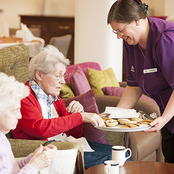 A carer with residents