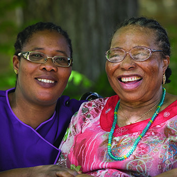 Two women smiling and laughing