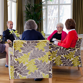 Group of people sitting in armchairs