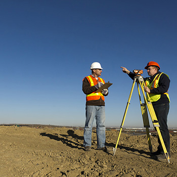 Two people surveying land