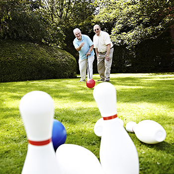 Two men playing bowls