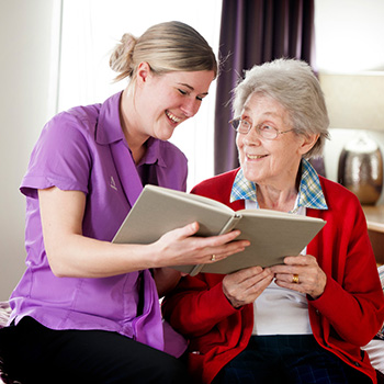 A carer and resident reading