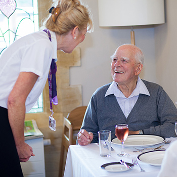 A resident talking to a carer